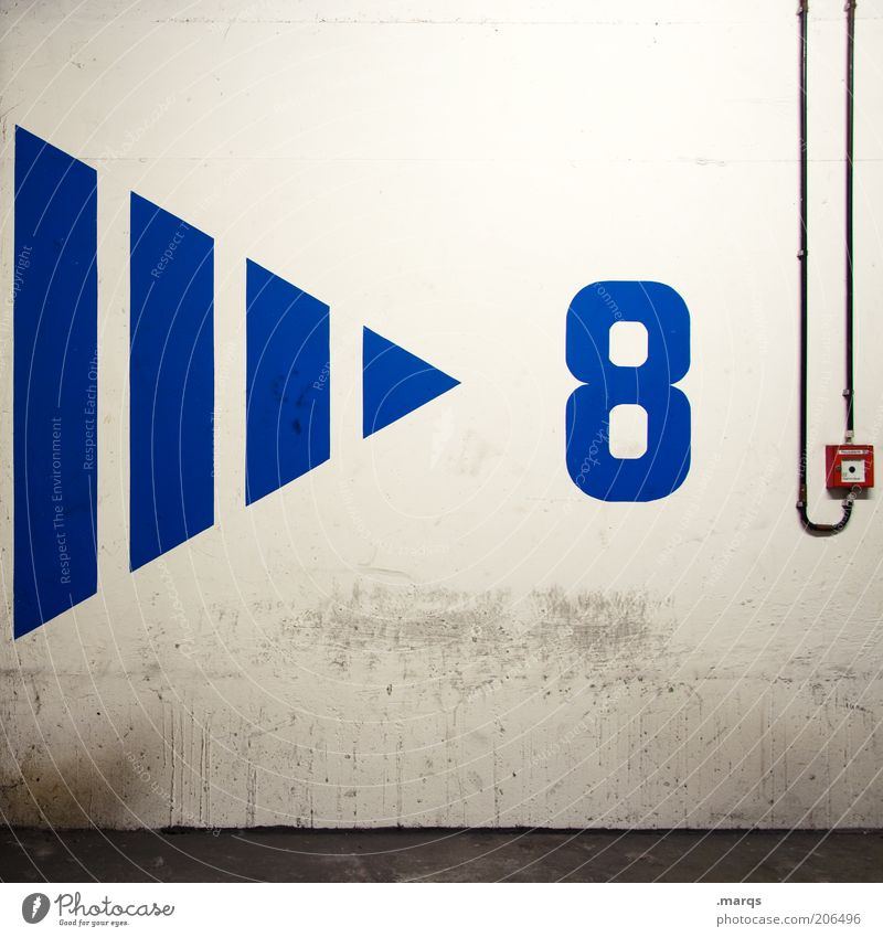 > 8 Wall (barrier) Wall (building) Concrete Digits and numbers Arrow Blue Fire alarm Colour photo Interior shot Artificial light Deserted Cable Switch Triangle