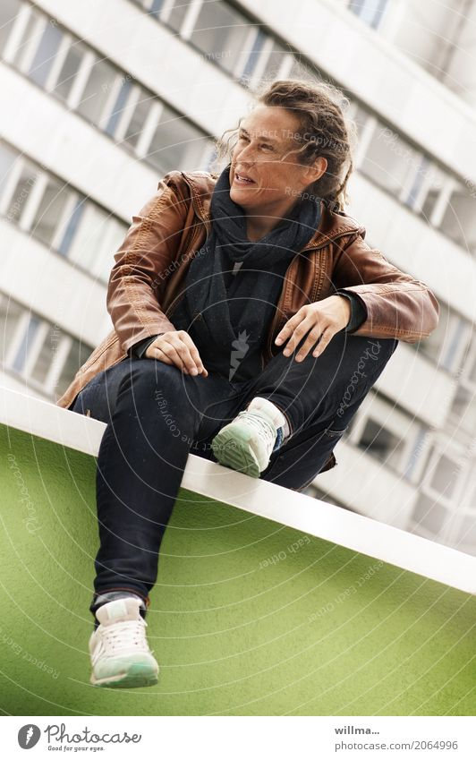 woman sitting casually on a wall with her knee raised Lifestyle Style Joy Human being Feminine Androgynous Young woman Youth (Young adults) Woman Adults 1