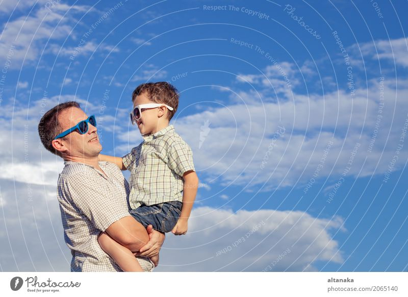 Father and son playing in the park Lifestyle Joy Relaxation Leisure and hobbies Playing Vacation & Travel Trip Adventure Freedom Camping Summer Sun Beach Child