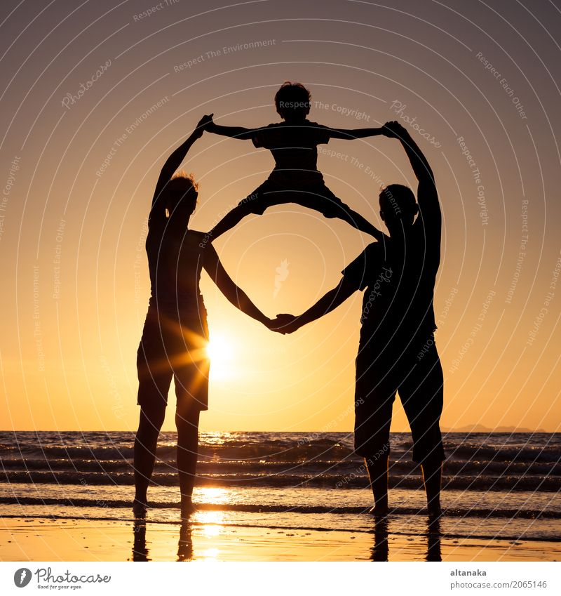 Silhouette of happy family Child Woman Nature Vacation & Travel Man Summer Sun Hand Ocean Joy Beach Adults Lifestyle Love Sports Boy (child)