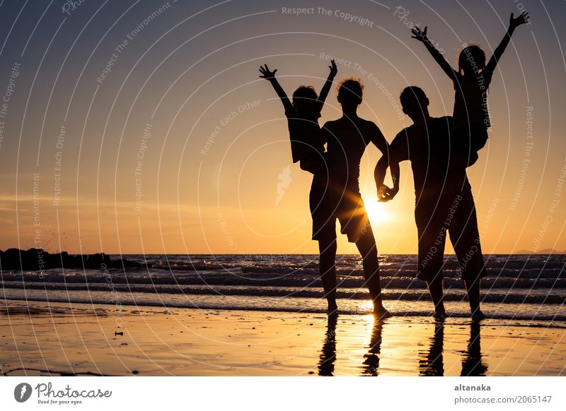 Silhouette of happy family Lifestyle Joy Leisure and hobbies Playing Vacation & Travel Trip Freedom Summer Sun Beach Ocean Sports Child Boy (child) Woman Adults