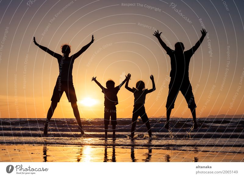 Silhouette of happy family Child Woman Nature Vacation & Travel Summer Sun Hand Ocean Joy Beach Adults Lifestyle Love Sports Boy (child) Family & Relations