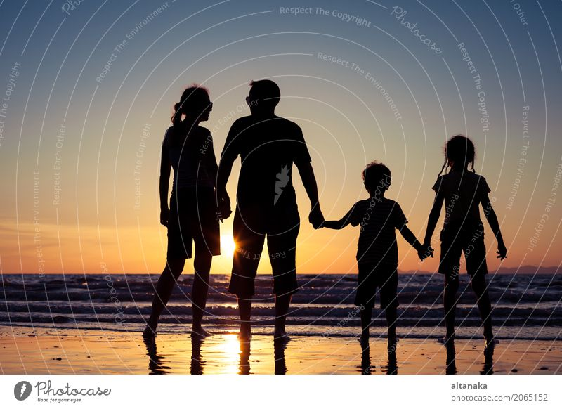 Silhouette of happy family Lifestyle Joy Leisure and hobbies Playing Vacation & Travel Trip Adventure Freedom Summer Sun Beach Ocean Sports Child Boy (child)