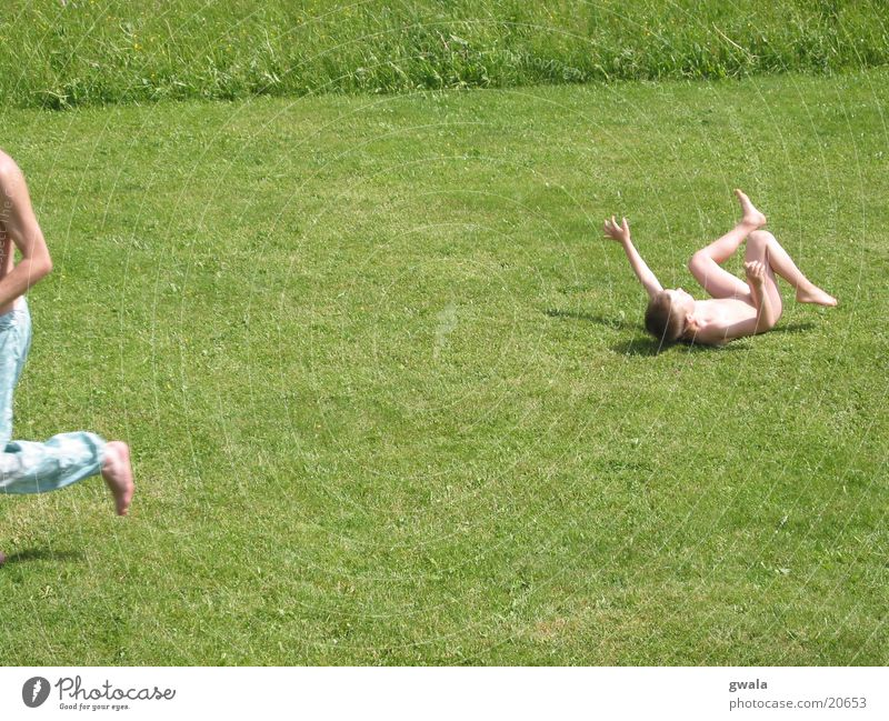 race Colour photo Exterior shot Day Sunlight Motion blur Child Human being Boy (child) Infancy 2 Nature Summer Grass Garden Meadow Running To fall Walking Lie