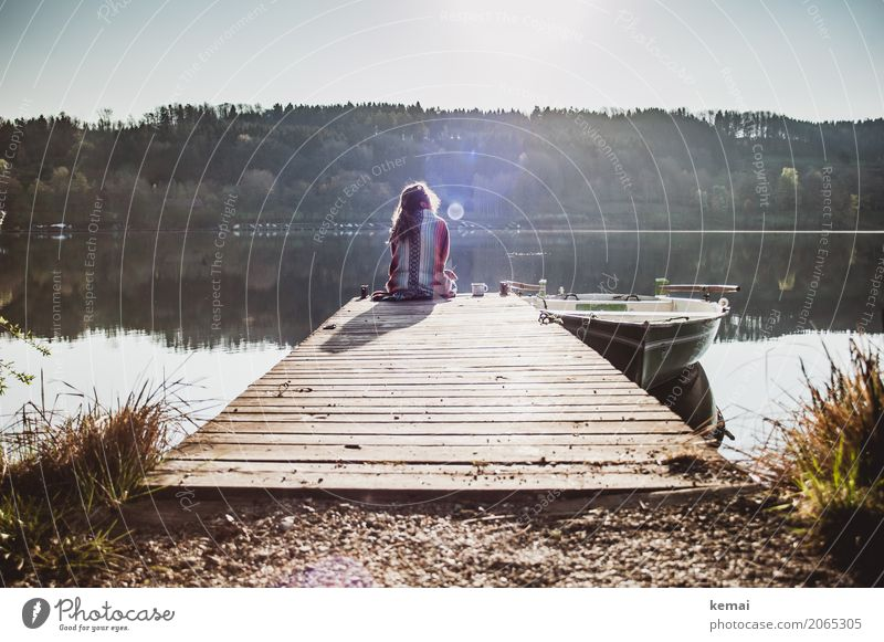 Woman sitting on a jetty by a lake in the morning Coffee Lifestyle Style Harmonious Well-being Contentment Senses Relaxation Calm Leisure and hobbies