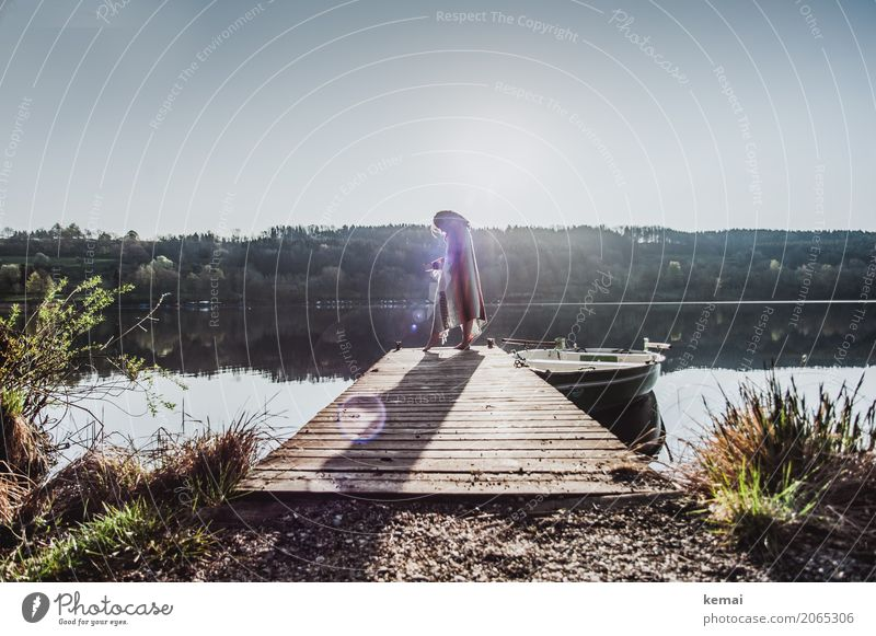 Woman at lake on jetty with blanket around her shoulders Lifestyle Elegant Style Harmonious Well-being Contentment Senses Relaxation Calm Leisure and hobbies