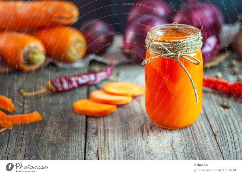 fresh carrot juice in a glass jar Vegetable Herbs and spices Vegetarian diet Diet Beverage Juice Glass Table Nature Autumn Wood Old Fresh Natural Juicy Gray