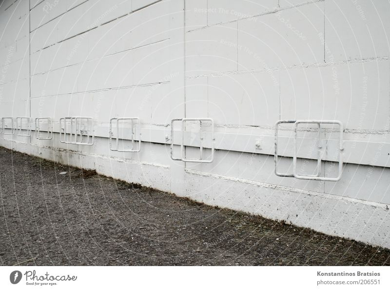 nice folding stand Wall (barrier) Wall (building) Facade Old Simple Under White Parking lot Free Metal Seam Bicycle rack Parking area Colour photo
