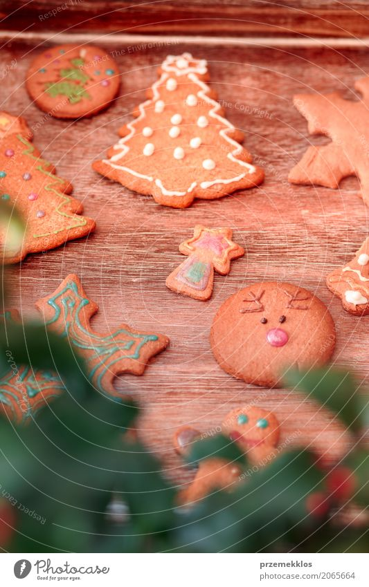 Christmas cookies decorated with frosting on wooden board Christmas & Advent Wood Food Feasts & Celebrations Decoration Table Candy Tradition Make Self-made Preparation Gingerbread Baking Tray Home-made Icing