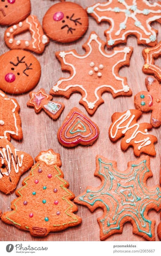 Christmas cookies decorated with frosting on wooden board Food Candy Decoration Table Feasts & Celebrations Christmas & Advent Wood Make Tradition Baking
