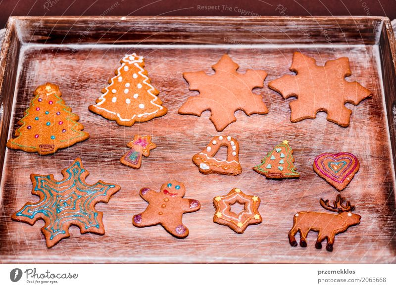 Christmas cookies decorated with frosting on wooden board Wood Feasts & Celebrations Decoration Table Tradition Make Self-made Preparation Gingerbread Baking Tray Home-made