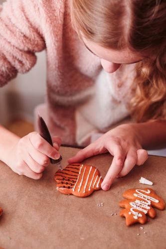 Girl decorating Christmas gingerbread cookies with chocolate Human being Youth (Young adults) Christmas & Advent Lifestyle Feasts & Celebrations Decoration