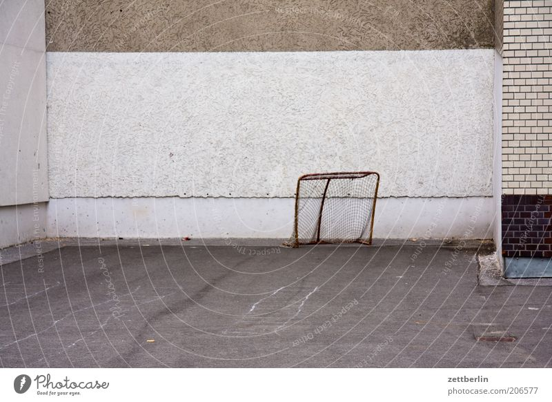 Calm Wall (building) Sports Wall (barrier) Leisure and hobbies Empty Gloomy Asphalt Brick Goal Backyard Copy Space Playground Football pitch Soccer Goal Sporting grounds