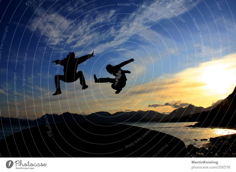 Fun in the Midnight Sun Sports Martial arts Landscape Mountain Lofotes Movement Flying Jump Esthetic Exceptional Cool (slang) Free Together Beautiful Crazy Blue