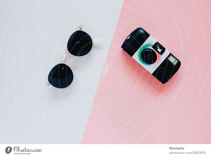 Creative flat lay style with camera and sunglasses Colour White Black Lifestyle Style Fashion Design Pink Bright Copy Space Leisure and hobbies Modern