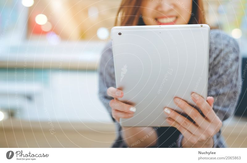 Young asian woman smiling and using tablet Woman Hand Adults Lifestyle Business Leisure and hobbies Office Modern Technology Success Smiling Computer Shopping