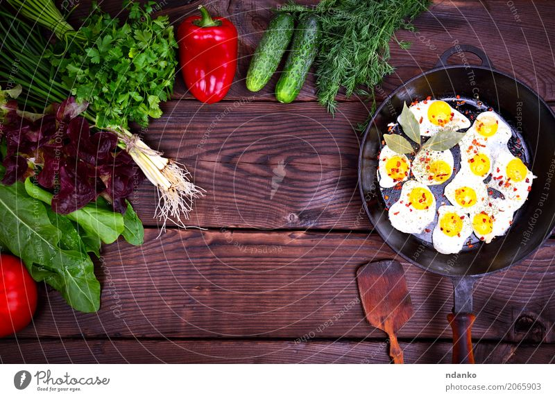 Fried quail eggs Herbs and spices Breakfast Lunch Dinner Pan Kitchen Restaurant Wood Eating Fresh Natural Above Brown Green Red Tradition Onion Dish lettuce