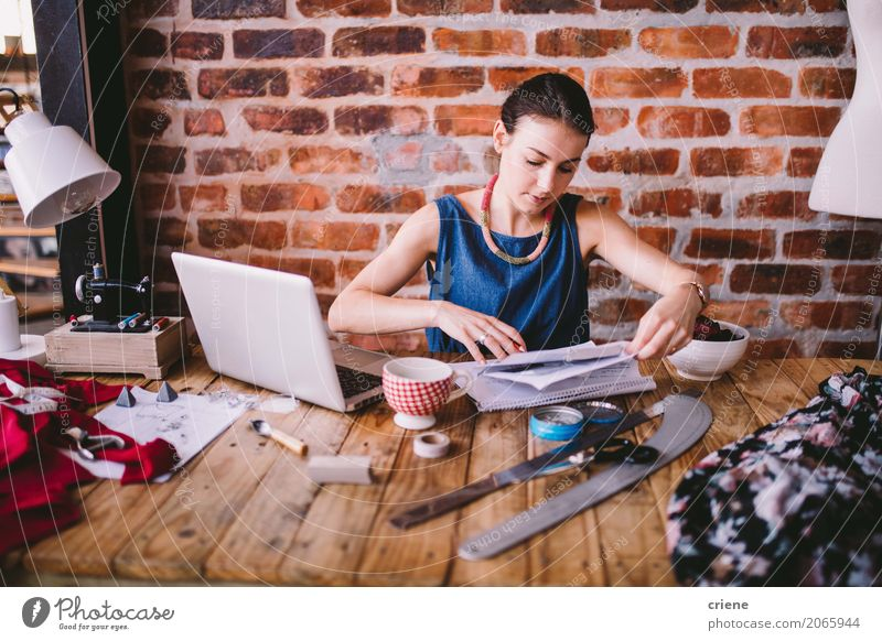 Businesswoman doing paperwork in office Human being Youth (Young adults) Young woman 18 - 30 years Adults Lifestyle Feminine Design Work and employment