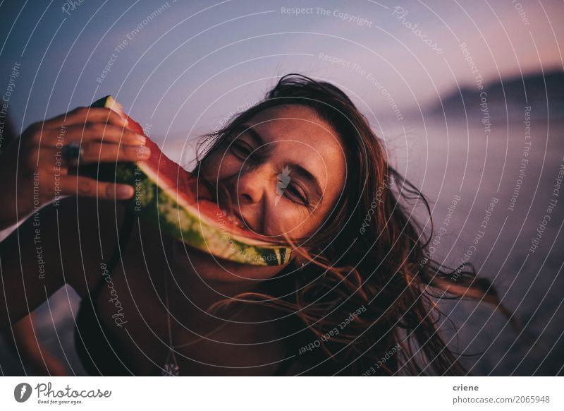 Woman eating watermelon on beach Food Fruit Nutrition Eating Lifestyle Joy Vacation & Travel Summer Beach Human being Feminine Young woman Youth (Young adults)