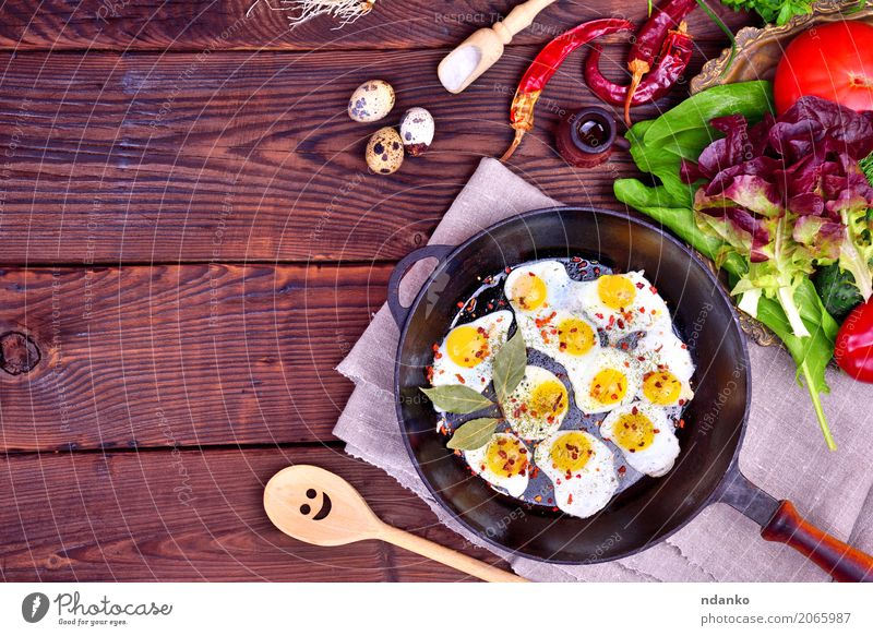 Fried quail eggs Bread Herbs and spices Breakfast Lunch Dinner Pan Spoon Kitchen Restaurant Fresh Natural Above Brown Green Red Tradition Onion Dish lettuce
