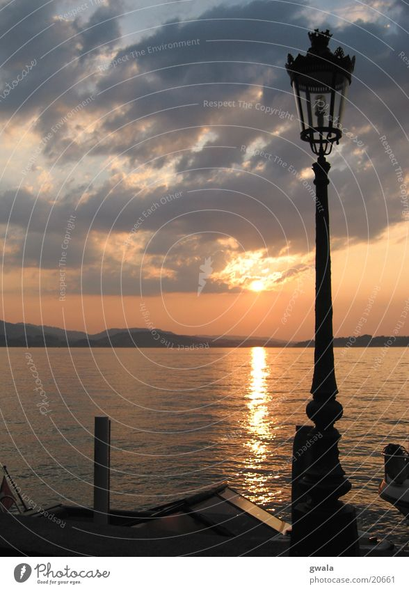 Water Sun Clouds Lake Orange Waves Kitsch Lantern Lakeside Sunrise Evening sun Lake Lucerne