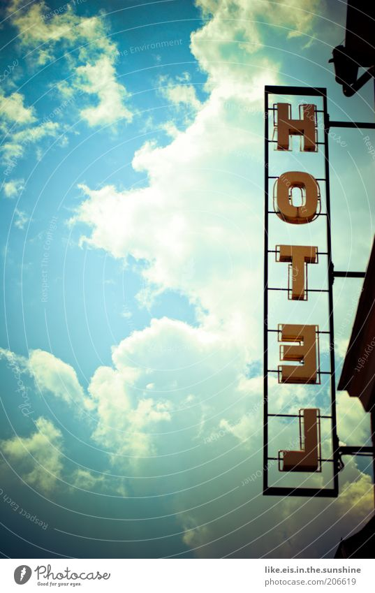 Sky Clouds Yellow Metal Signs and labeling Letters (alphabet) Advertising Hotel Beautiful weather Neon sign Nature Among each other