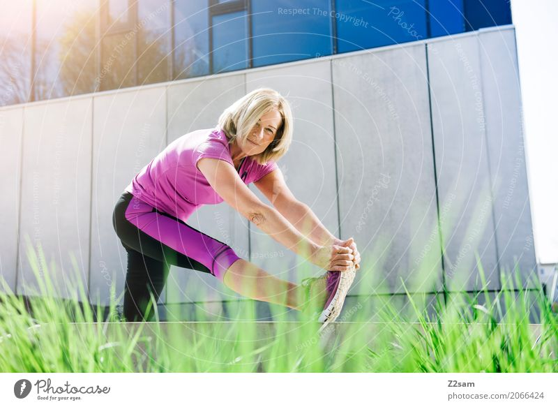 Pensioner stretching Leisure and hobbies Sports Fitness Sports Training Yoga Woman Adults Female senior 45 - 60 years bushes Town Sneakers Blonde Relaxation