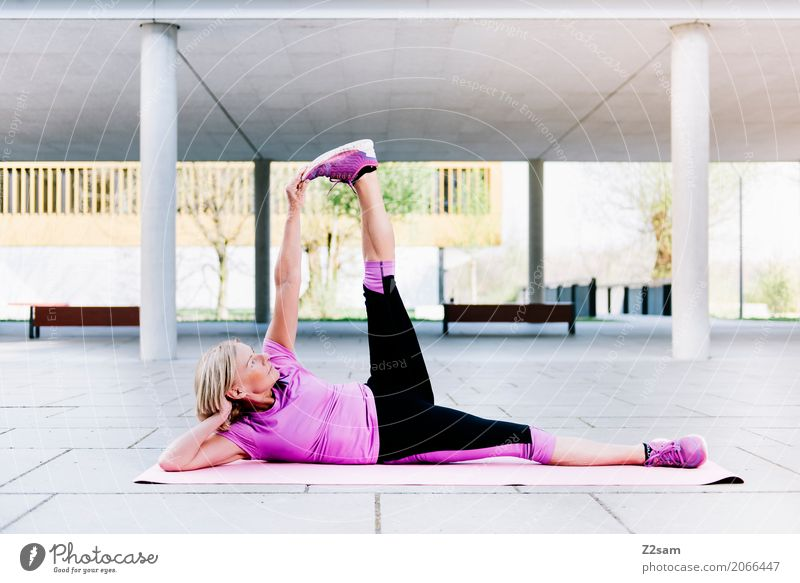 stretching Lifestyle Style Leisure and hobbies Sports Fitness Sports Training Yoga Woman Adults Female senior 60 years and older Senior citizen Town Deserted