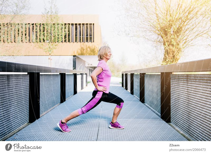 stretching Lifestyle Sports Fitness Sports Training Yoga Warming up Woman Adults 60 years and older Senior citizen Sun Summer Beautiful weather Town Sportswear