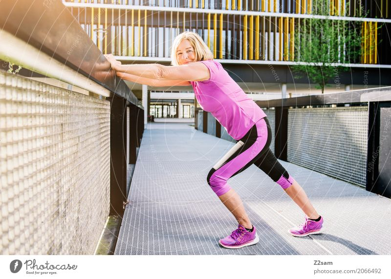 stretching Lifestyle Leisure and hobbies Sports Fitness Sports Training Woman Adults Female senior 60 years and older Senior citizen Sun Summer Town Sportswear