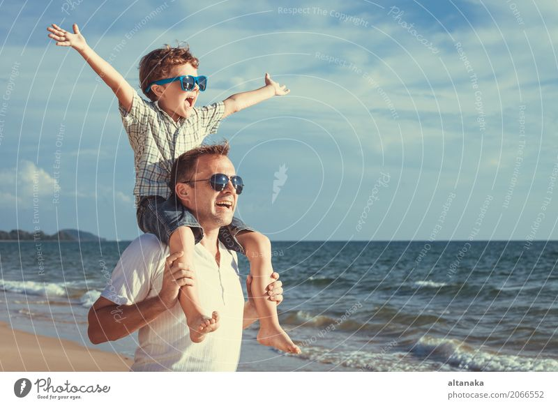 Father and son playing on the beach Lifestyle Joy Relaxation Leisure and hobbies Playing Vacation & Travel Trip Adventure Freedom Summer Sun Beach Ocean Child