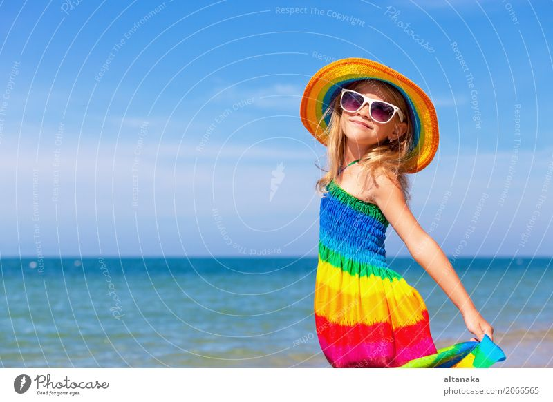Little girl standing on the beach Human being Child Woman Nature Vacation & Travel Summer Sun Hand Ocean Relaxation Joy Beach Adults Lifestyle Emotions
