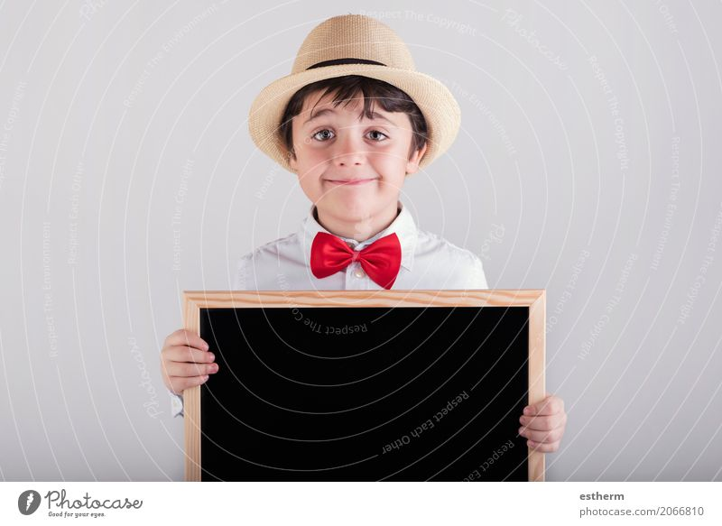 smiling child holding a blackboard Human being Child Joy Lifestyle Funny Boy (child) Laughter School Masculine Infancy Happiness Smiling Study Warm-heartedness