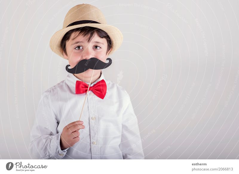 Funny boy with fake mustache Human being Child Joy Adults Lifestyle Love Emotions Boy (child) Feasts & Celebrations Together Friendship Masculine Infancy