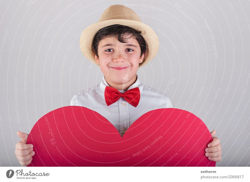 smiling boy with a red heart Human being Child Joy Lifestyle Love Funny Boy (child) Laughter Feasts & Celebrations Together Friendship Masculine Infancy
