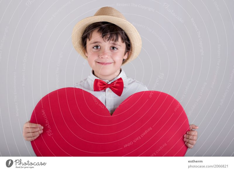 smiling boy with a red heart Human being Child Joy Lifestyle Love Funny Boy (child) Laughter Happy Feasts & Celebrations Together Friendship Masculine Infancy