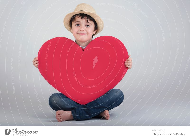 smiling boy with a red heart Human being Child Joy Lifestyle Love Emotions Boy (child) Feasts & Celebrations Together Friendship Masculine Infancy Happiness