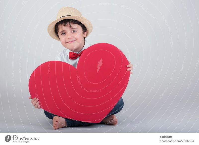 smiling boy with a red heart Human being Child Joy Lifestyle Love Boy (child) Laughter Feasts & Celebrations Together Friendship Masculine Infancy Happiness