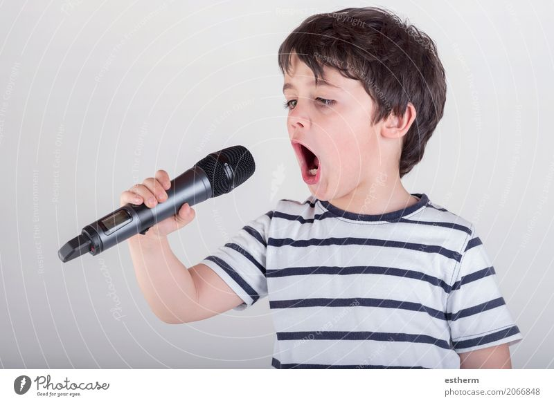 Boy singing to microphone Human being Child Joy Lifestyle Boy (child) Party Leisure and hobbies Masculine Infancy Music Success Happiness Culture To enjoy Shows