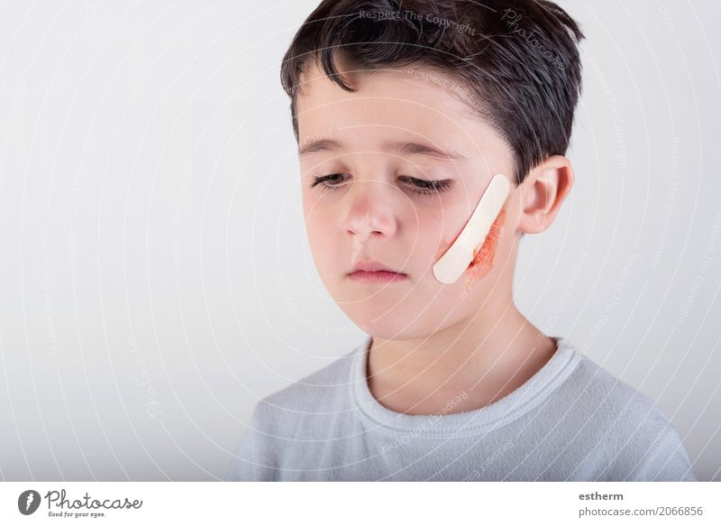 boy with a plaster on His face Human being Child Loneliness Sadness Healthy Boy (child) Health care Think Masculine Fear Infancy Dangerous Threat Grief Pain