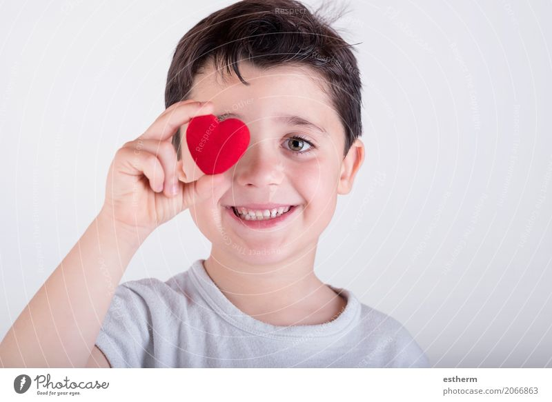 little boy covering her eye with heart Human being Child Life Lifestyle Love Healthy Boy (child) Laughter Health care Happy Feasts & Celebrations Masculine