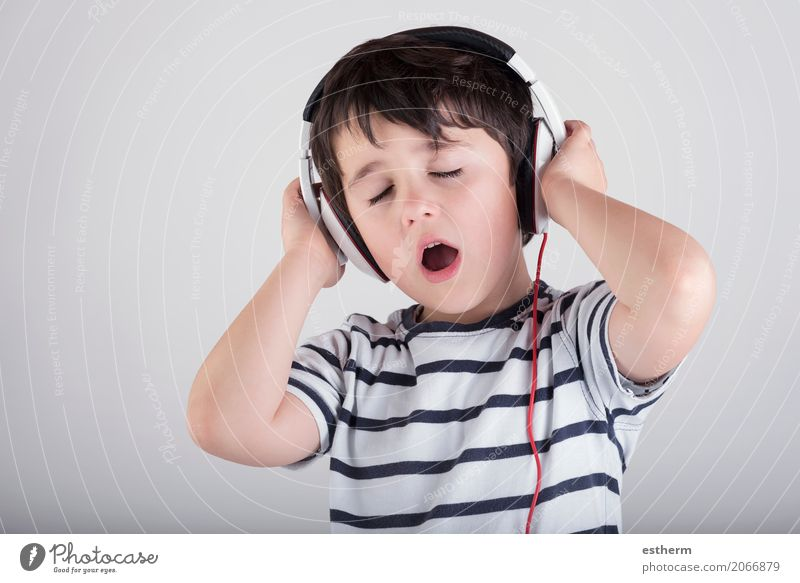 Child with headphones, listening to music Human being Relaxation Joy Boy (child) Party Moody Leisure and hobbies Masculine Infancy Music Happiness Culture