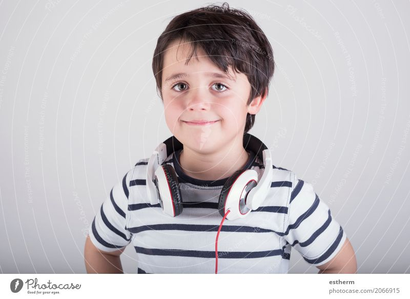 Child with headphones, listening to music Human being Relaxation Joy Lifestyle Emotions Boy (child) Laughter Party Leisure and hobbies Masculine Infancy Music
