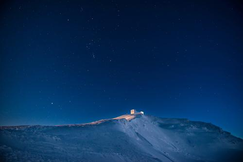 Old castle on the on of winter mountain with snow at night Vacation & Travel Trip Adventure Far-off places Winter Snow Mountain House (Residential Structure)