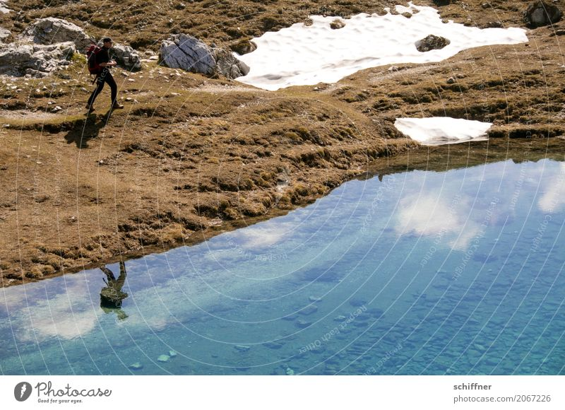 Human being Sky Nature Man Landscape Clouds Mountain Adults Environment Snow Lake Rock Going Hiking Masculine Alps
