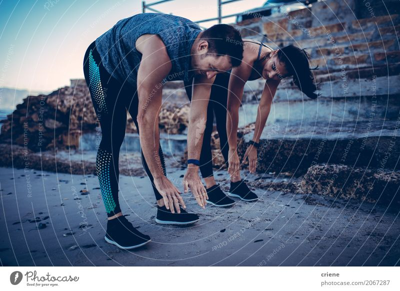 Young athlete couple doing stretching exercise together Lifestyle Joy Happy Wellness Well-being Leisure and hobbies Beach Sports Human being Woman Adults Man