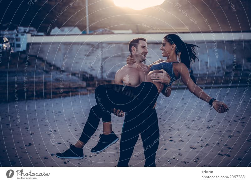 Man carrying his girlfriend on arms on beach Lifestyle Joy Happy Beach Sports Fitness Sports Training Human being Masculine Feminine Woman Adults Couple