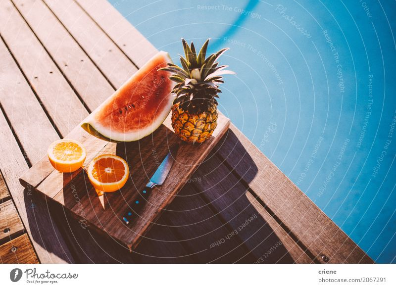 Plate with Tropical fruits next to swimming pool Food Fruit Orange Nutrition Eating Lifestyle Swimming pool Swimming & Bathing Leisure and hobbies Summer