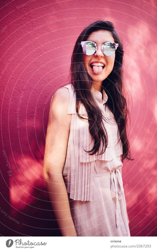 Happy young woman stretching out her tongue Lifestyle Joy Human being Feminine Young woman Youth (Young adults) Woman Adults 1 18 - 30 years Sunglasses Brunette
