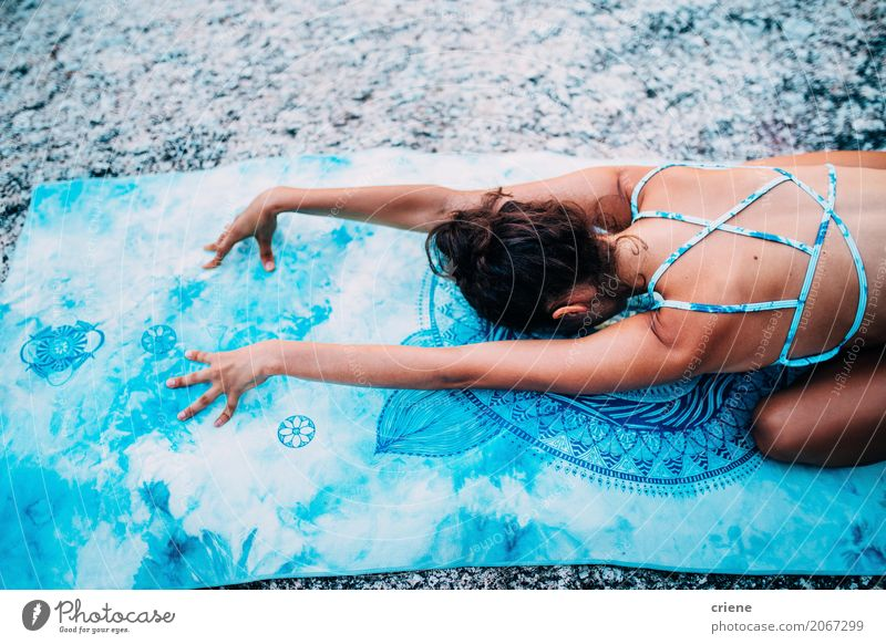 Back view of woman lying on yoga towel meditation Human being Woman Youth (Young adults) Young woman Summer Adults Natural Sports Feminine Rock Bright Body